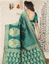 photo of Fancy Function Wear Banarasi Silk Teal Saree With Jacquard Work
