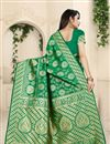 photo of Banarasi Silk Fabric Designer Weaving Work Saree In Green Color With Attractive Blouse