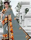 image of Grey Color Georgette Designer Saree With Unstitched Raw Silk Blouse