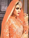 photo of Orange Designer Party Wear Georgette Palazzo Suit