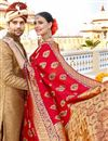 photo of Red Kanchipuram Silk Fabric Function Wear Saree With Weaving Work And Astounding Blouse