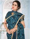 photo of Teal Embroidery Work On Art Silk Fabric Occasion Wear Saree