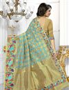 photo of Party Wear Banarasi Silk Fabric Beige And Sky Blue Color Saree With Archetypal Work