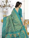 photo of Party Wear Banarasi Silk Fabric Cyan Color Saree With Archetypal Work