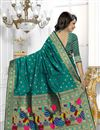 photo of Party Wear Banarasi Silk Fabric Teal Color Saree With Archetypal Work