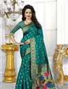 image of Party Wear Banarasi Silk Fabric Teal Color Saree With Archetypal Work