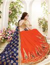 photo of Beautifully Embroidered Orange And Blue Color Designer Saree In Fancy Silk Fabric