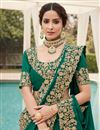 photo of Green Color Puja Wear Fancy Art Silk Fabric Embroidery Work Saree