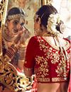 photo of Red Embroidered Fancy Fabric Bridal Wear Lehenga