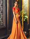 photo of Party Wear Orange Designer Embellished Saree In Fancy Fabric With Heavy Blouse