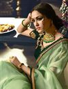 photo of Party Wear Sea Green Designer Embellished Saree In Fancy Fabric With Heavy Blouse