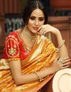 photo of Art Silk Fabric Golden Color Party Wear Saree With Weaving Work And Charming Blouse