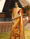 image of Art Silk Fabric Golden Color Party Wear Saree With Weaving Work And Charming Blouse
