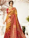 image of Eid Special Traditional Wear Orange Color Designer Jacquard And Silk Fabric Saree With Embroidered Blouse