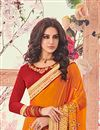 photo of Orange Party Wear Saree In Georgette With Heavy Lace Border