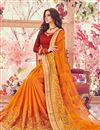 image of Orange Party Wear Saree In Georgette With Heavy Lace Border