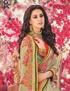photo of Party Wear Cream Designer Saree In Georgette With Heavy Lace Border