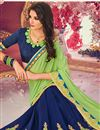photo of Embroidered Georgette Fancy Saree In Blue And Sea Green With Lace Border