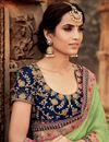 photo of Navy Blue And Sea Green Wedding Wear Embellished Saree In Georgette With Designer Blouse