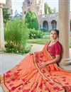photo of Designer Fancy Orange Color Georgette Fabric Wedding Wear Embroidered Saree With Lace Border