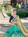 photo of Designer Fancy Cyan And Beige Color Georgette Fabric Wedding Wear Embroidered Saree With Lace Border