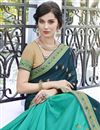 photo of Wedding Special Fancy Stone Work Embroidered Georgette And Art Silk Teal Designer Saree