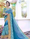 image of Wedding Special Fancy Stone Work Embroidered Sky Blue Georgette And Satin Designer Saree