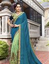 image of Designer Jacquard And Georgette Fancy Embroidered Saree In Sea Green And Teal