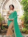 image of Embroidered Teal And Chikoo Net Function Wear Saree
