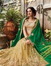photo of Green And Cream Embroidered Net Party Wear Saree