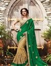 image of Wedding Special Green And Cream Embroidered Net Party Wear Saree