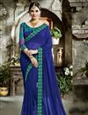 image of Fancy Fabric Blue Plain Saree With Embroidered Blouse And Border