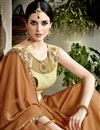 photo of Embroidered Blouse And Border On Coffee Color Saree In Fancy Fabric