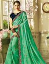 image of Embroidered Sea Green Georgette And Art Silk Fancy Saree