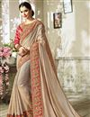 image of Eid Special Embroidered Cream Georgette And Art Silk Fancy Saree