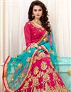 photo of Wedding Wear Designer Embroidered Lehenga In Rani Color Net With Party Wear Blouse