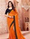 image of Crepe Designer Orange Saree With Fancy Lace