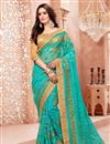 image of Net Designer Saree In Cyan With Fancy Lace Border