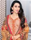 photo of Karishma Kapoor Straight Cut Cotton Fabric Printed Salwar Kameez In Chikoo Color