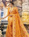 image of Orange Color Wedding Wear Art Silk Saree With Weaving Work