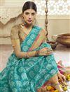 photo of Print Designs On Cyan Cotton Silk Fabric Festive Wear Saree