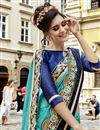 photo of Beguiling Embroidery Work On Cyan Fancy Fabric Festive Wear Saree
