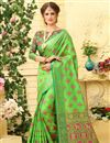 image of Weaving Work On Patola Style Party Wear Jacquard Silk Saree In Sea Green