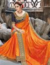 photo of Embroidery Work On Party Wear Saree In Orange Chiffon Fabric With Charming Blouse