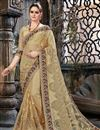 image of Beige Embroidery Designs On Net Fabric Party Wear Saree With Attractive Blouse