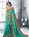 image of Embroidery Designs On Light Teal Color Georgette Fabric Party Wear Saree