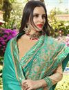 photo of Party Style Fancy Embroidered Saree In Cyan Art Silk With Lace Border