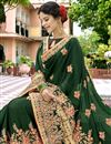 photo of Georgette Fabric Fancy Party Wear Embroidered Saree In Dark Green With Lace Border