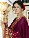 photo of Party Style Fancy Embroidered Saree In Georgette Fabric Burgundy Color With Lace Border