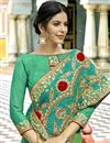photo of Party Style Fancy Embroidered Saree In Georgette Fabric Cyan With Lace Border